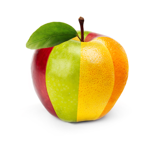 An apple with vertical stripes of different textures (apple and citrus skin)